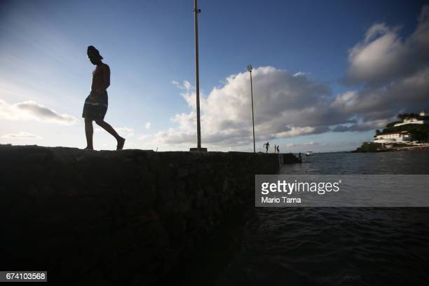 A young man walks on a pier in the Barra neighborhood on April 19 2015 in Salvador Brazil