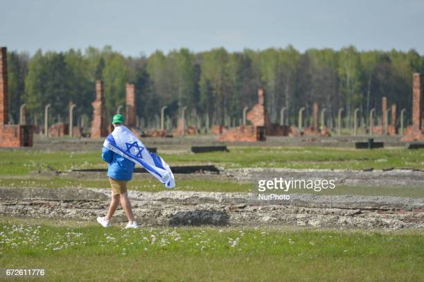 A young man walks through the remains of the former camp during the annual March of the Living inside the former German Nazi Death Camp...