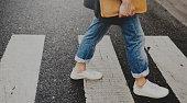 Young man wallking crosswalk commuter lifestyle
