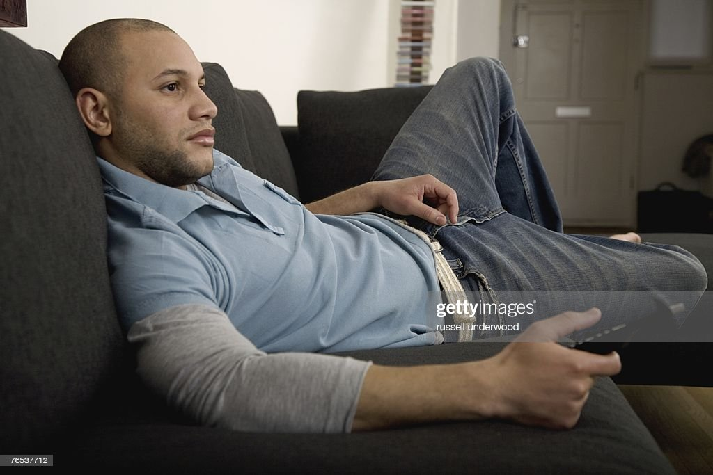 Young man watching television