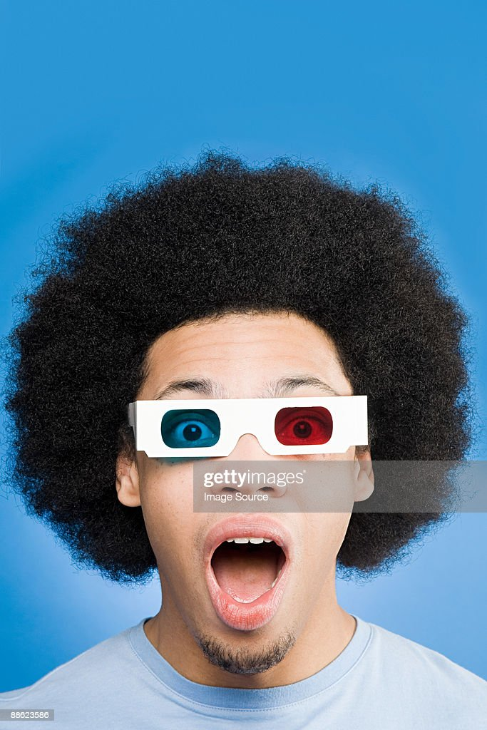 A young man wearing 3d glasses