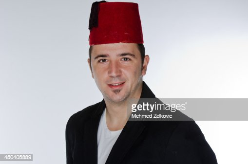 Young Man Wearing a Fez Hat