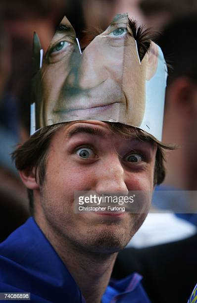 A young man wearing a homemade paper crown cut from a photograph depicting Nicolas Sarkozy gathers with other Sarkozy supporters outside the Salle...