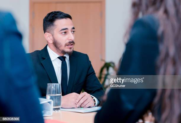 Young man wearing business suit attending an interview