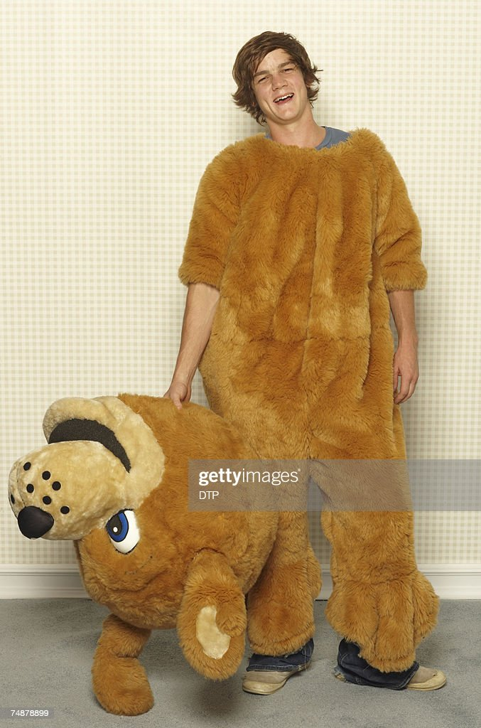 Young man wearing dog costume, smiling, portrait : Stock Photo