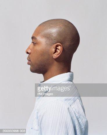 Young man wearing earing, close-up, profile