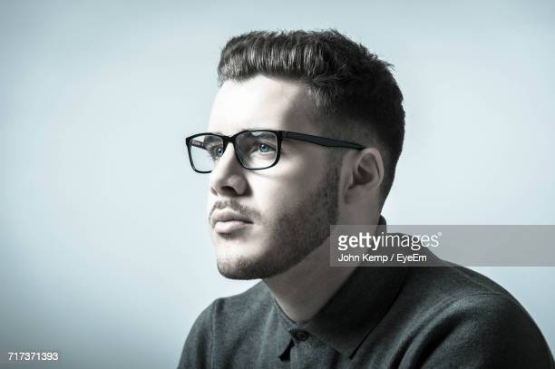 Young Man Wearing Eyeglasses Against White Background