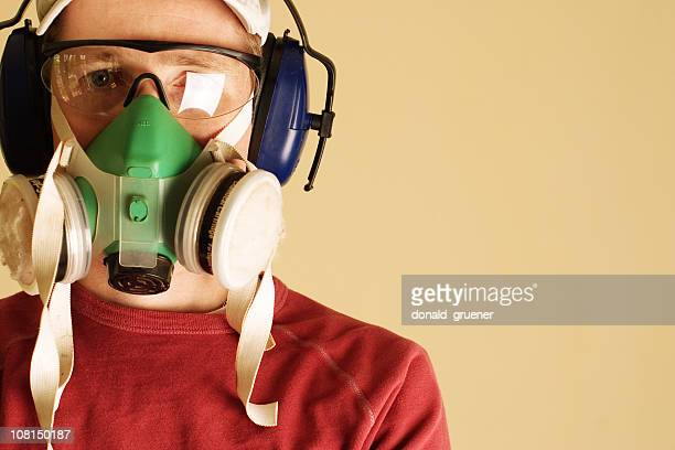 Young man wearing goggles, respirator, and ear muffs