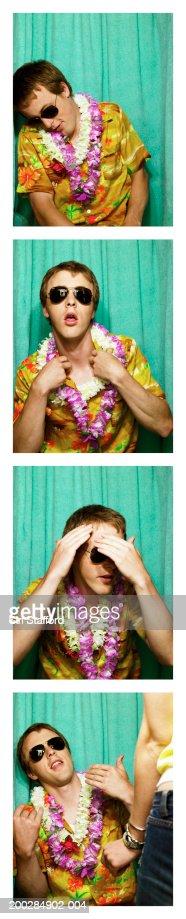Young man wearing camisa hawaiana y leis en cabina de fotos : Foto de stock