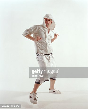 Young man wearing hooded top dancing, portrait