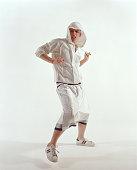 Young man wearing hooded top dancing, portrait