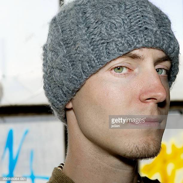 Young man wearing knit cap, close-up, portrait