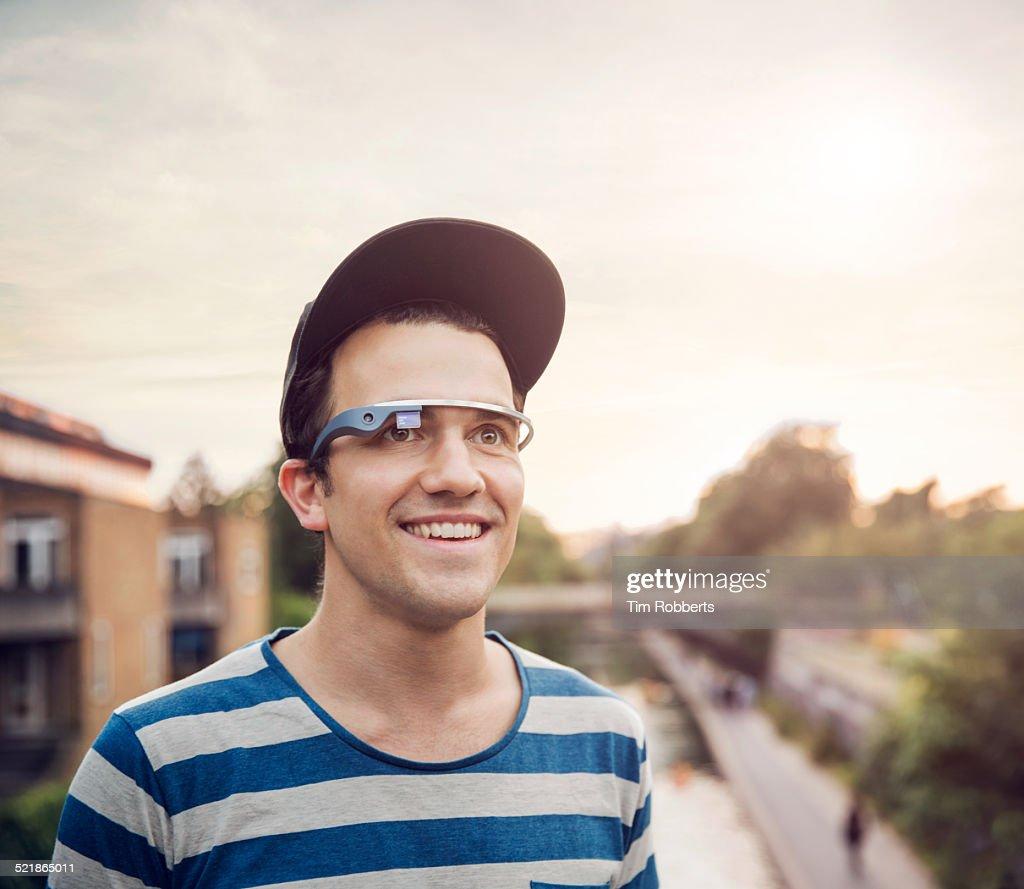 Young man wearing smart glass.