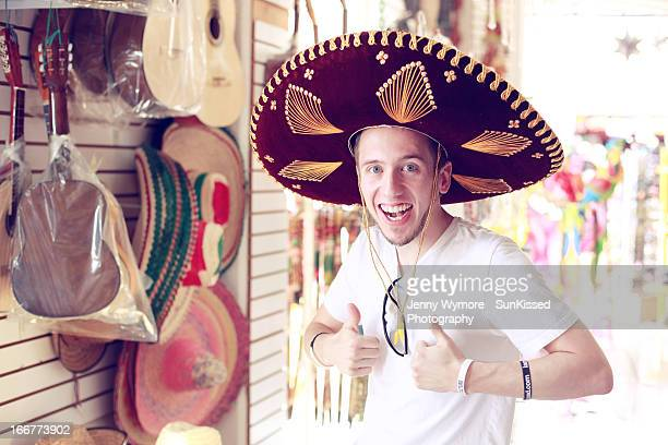 Young man wearing sombrero hat.