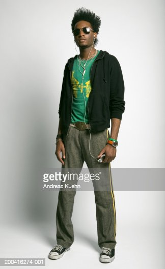 Young man wearing sunglasses and headphones, portrait : Stock Photo