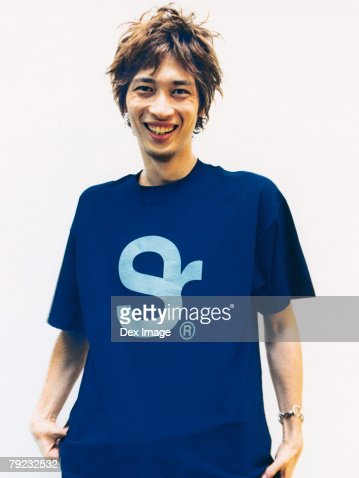 Young man wearing tee shirt, portrait : Stock Photo