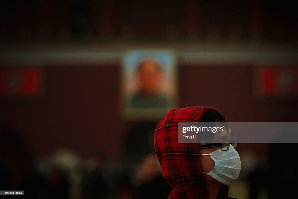 A young man wearing the mask visits the Tiananmen Square during the sandstorm on February 28, 2013 in Beijing, China. Beijing was hit by its first sandstorm of the year while its air quality reached dangerous level on Thursday.
