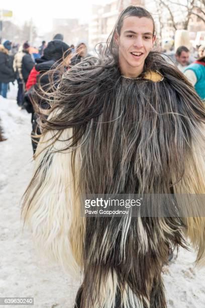 Young Man Wearing Traditional Kukeri Costume  During A Traditional Kukeri Festival