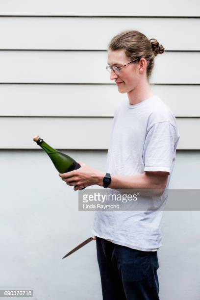 A young man who sabre champagne'n