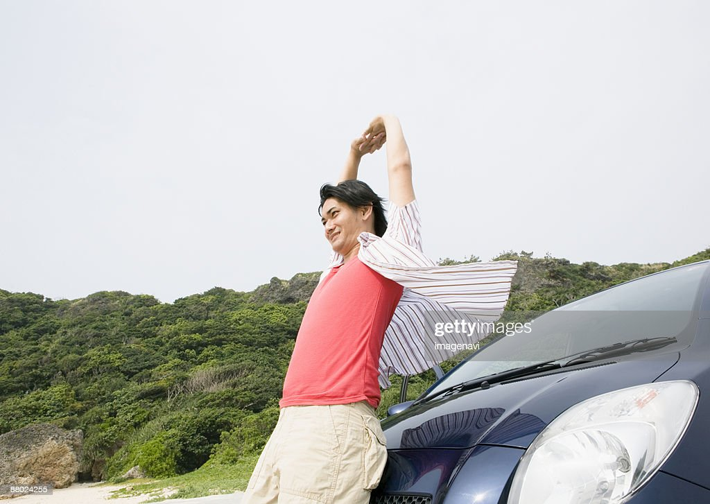 A young man with a car