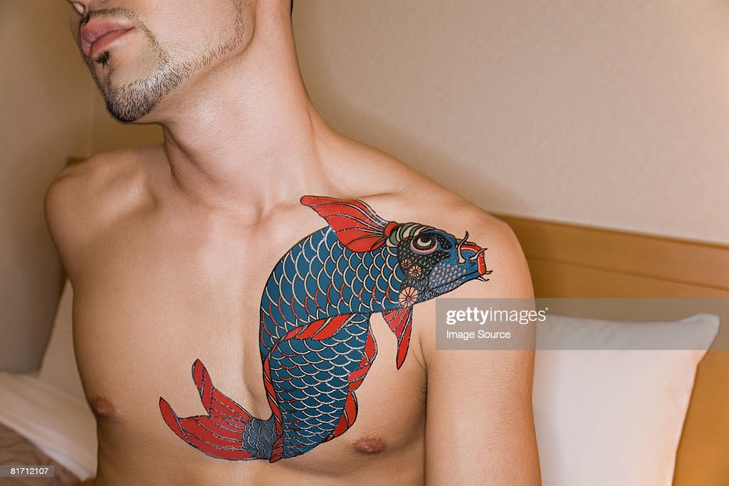 Young man with a carp tattoo