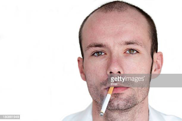 Young man with a cigarette in his mouth