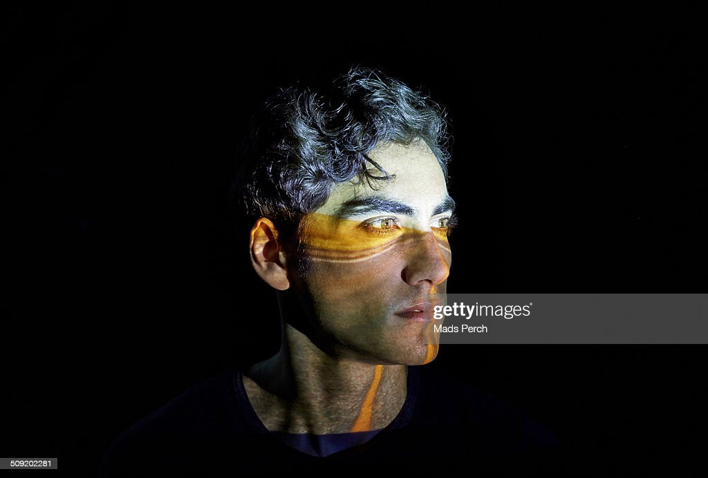 Young Man with a Highway Projected on to his face