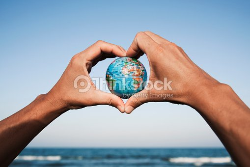 young man with a world globe in his hands : Stock Photo