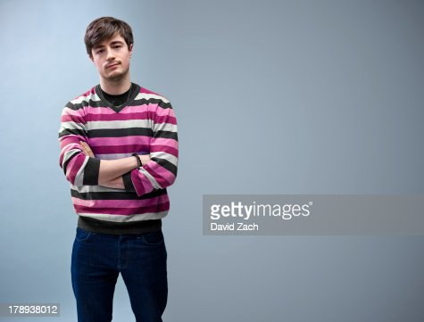 Young man with arms folded, portrait