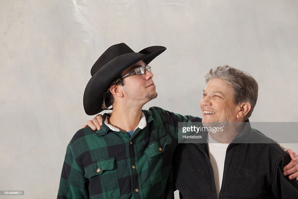 Young man with autism and his mentor looking at each other and smiling