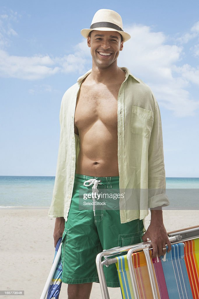 Young man with beach equipment : Stock Photo