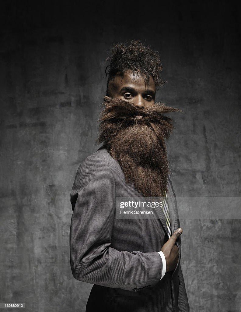 young man with big beard, posing like napoleon : Stock Photo