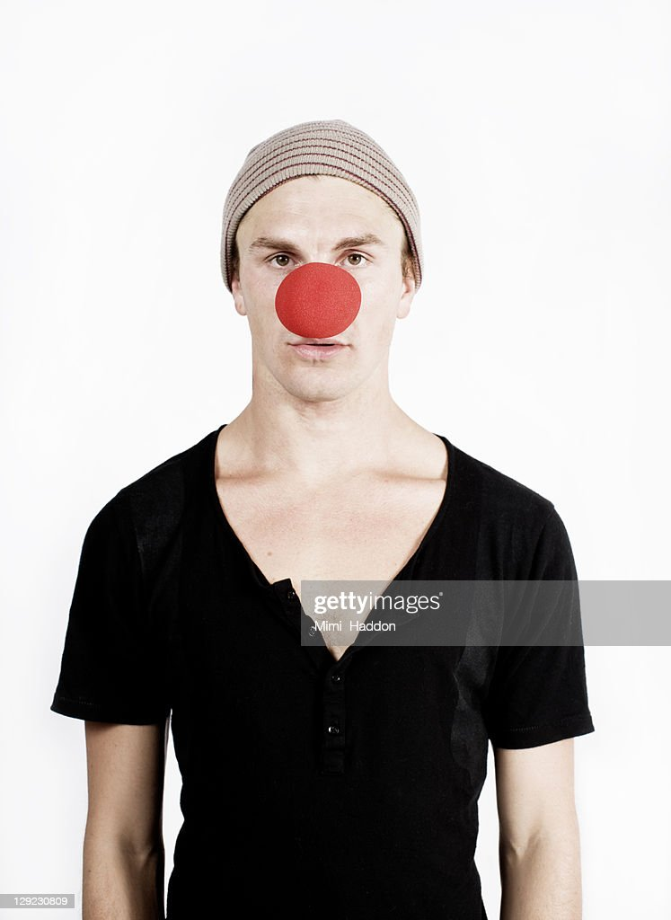 Young Man with Big Red Clown Nose : Stock Photo