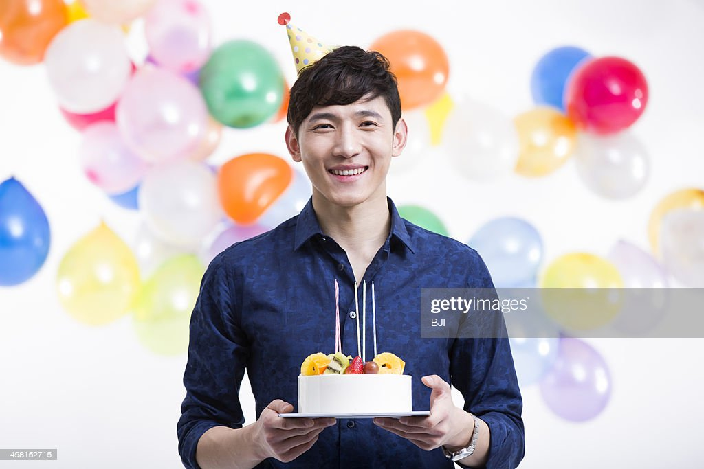 Young Man With Birthday Cake Stock Photo Getty Images