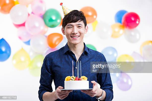 Young man with birthday cake
