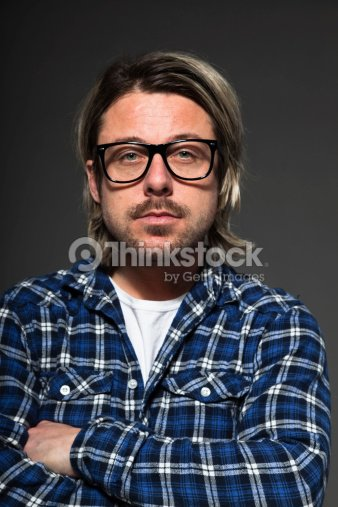 Junger Mann Mit Blonden Haar Und Bart Mit Retro Brille Stock Foto
