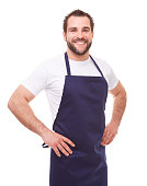 Happy man with blue apron on white background,