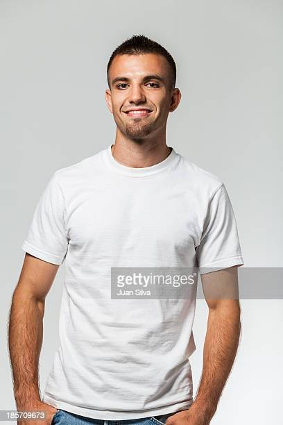 Young man with blue jeans and T-Shirt smiling