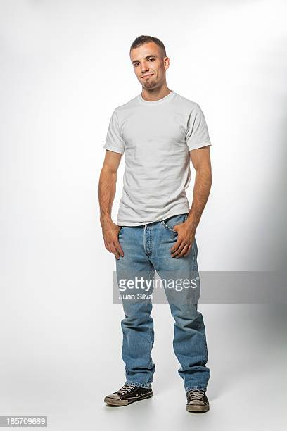 Young man with blue jeans and T-Shirt standing on