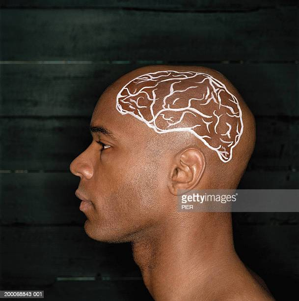 Young man with brain painted on side of shaved head, profile