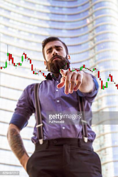 Young man (Hipster style) with candlestick patterns