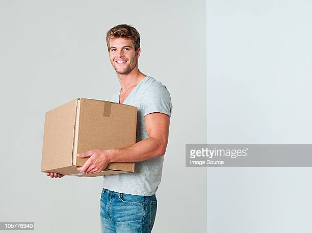Young man with cardboard box