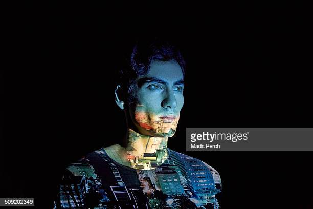 Young Man with Cityscape Projected on to him