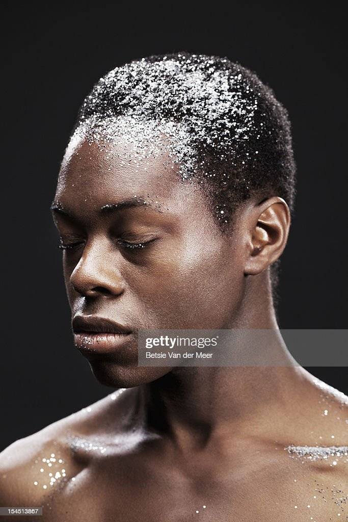 Young man with closed eyes, sparkles on forehead. : Stock Photo