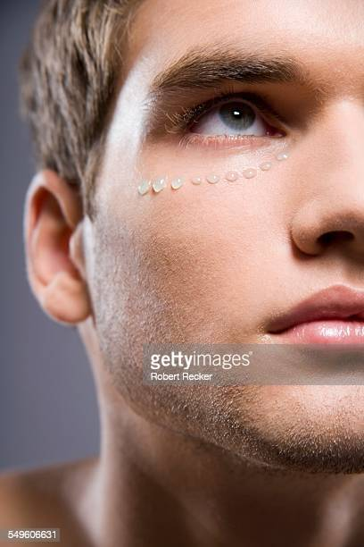 Young Man with Cream Around His Eye
