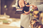 Young man with credit cards in purse in hands