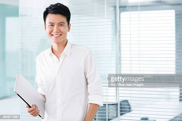 Young man with digital tablet in office