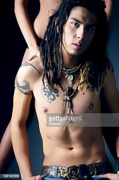 Young man with Dreadlocks and Tattoos