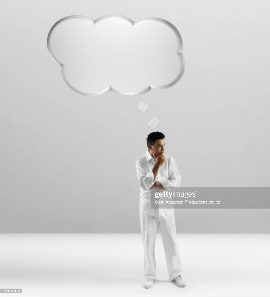 Young man with empty thought balloon over his head : Stock Photo