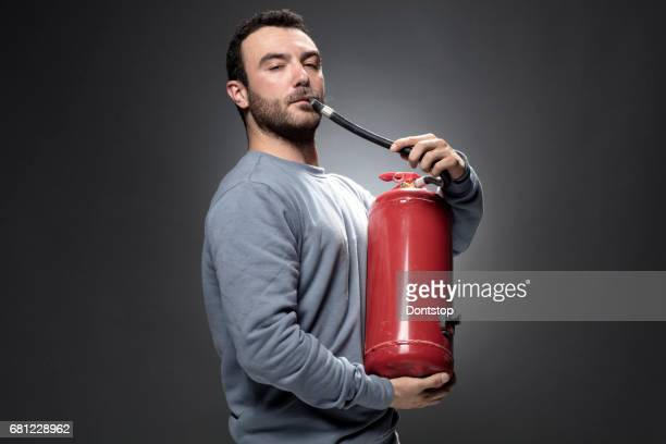Young Man with fire extinguisher